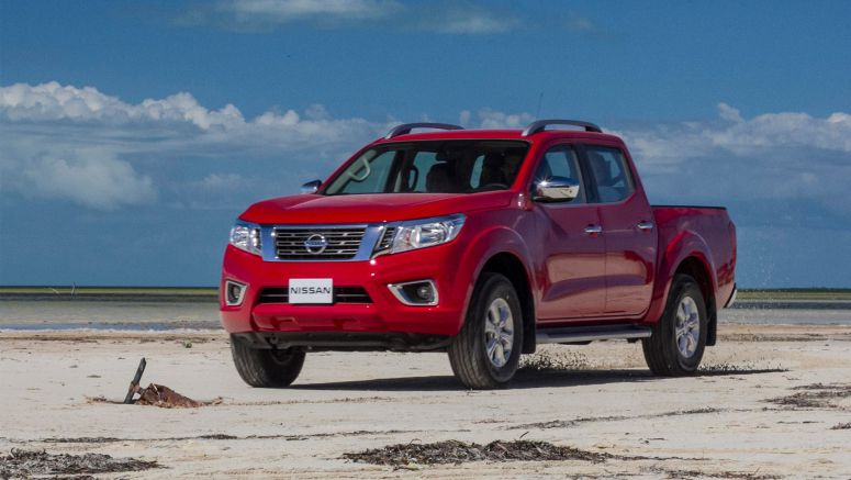 Nissan Mexico exports its five-millionth vehicle, a red Nissan NP300 Frontier pickup, to Colombia