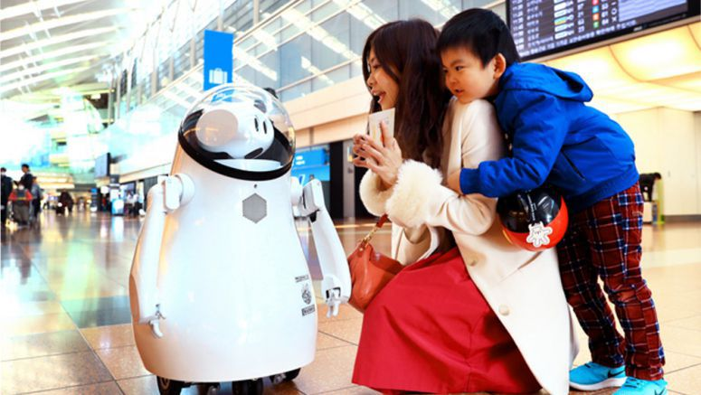 Robots lend a helping hand to visitors at Haneda Airport