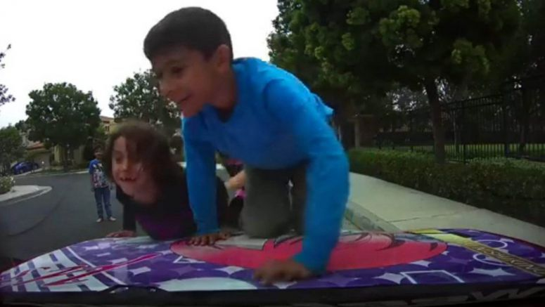 Dashcam Catches Kids Playing On The Hood Of A Customized Mazda Miata