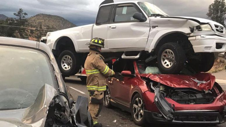 Mazda Pickup Somehow Balances On Honda After Crash