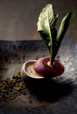 Savor whole red turnip, soup in the hollowed out base of vegetable