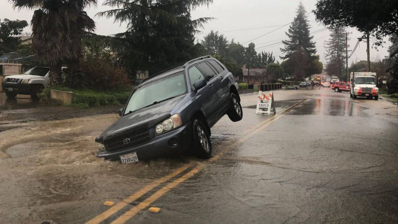 Sammy The Sinkhole Takes A Bite Out Of Toyota Highlander, Leaves It In Limbo