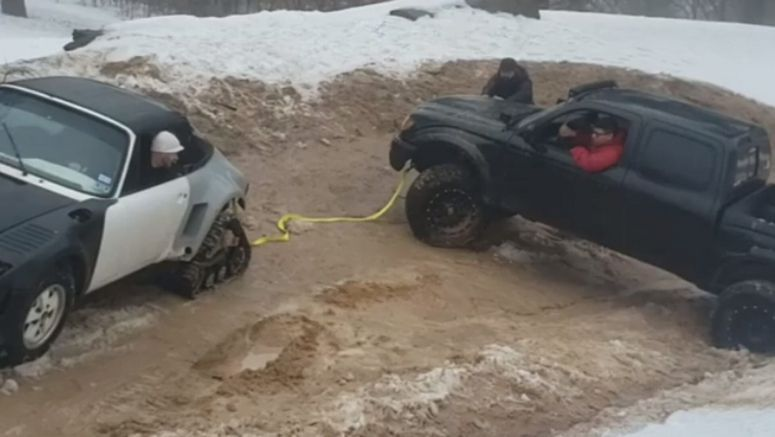 Porsche 911 On Tracks Rescues A Toyota Pickup Stuck In The Mud