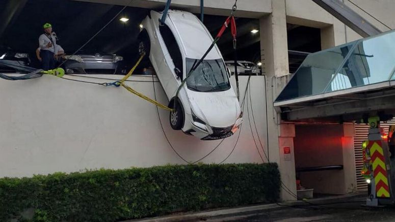 Woman Crashes Through Retaining Cables, Gets Her Lexus Stuck Dangling Over Parking Garage