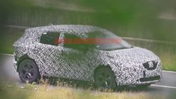 Nissan Rogue Sport spied covered in camo from atop a tree