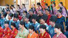 Students enjoy coming-of-age ritual in bright historical outfits