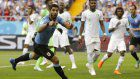 Soccer: Suarez sends Uruguay, and Russia, to last 16 at World Cup