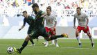 Soccer: Australia gets crucial 1-1 draw with Denmark at World Cup