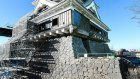 Kumamoto Castle's fortified curved stone walls rise again