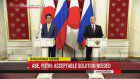 Abe, Putin agree to continue talks on peace treaty