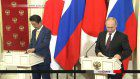 Abe, Putin: Acceptable solution needed