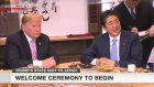 Abe, Trump relax ahead of talks