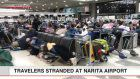 Travelers stranded at Narita airport