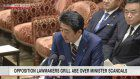 Opposition lawmakers grill Abe