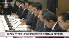 Japan steps up measures to contain spread