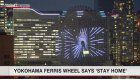 Ferris wheel in Yokohama lit up with 'Stay home'