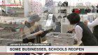 Some businesses, schools reopen in Japan