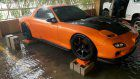 Mazda RX-7 threatened by floodwaters gets help from a stranger