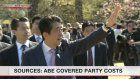 Sources: Abe's office covered some party costs