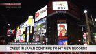 Japan reports record number of new infections