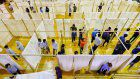Architect's cardboard tube and cloth partitions bring privacy to evacuation centers
