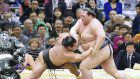 Kisenosato keeps record unblemished