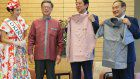 Okinawa governor's pink shirt gift to Abe briefly lightens tensions