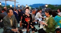 Warm welcome in Kyoto for 'cool floor' ritual by Kamogawa river
