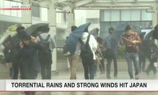 Torrential rains and strong winds hit Japan