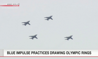 Aerobatic team practices drawing Olympic ring