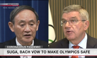 Suga, Bach agree to work on holding safe Olympics
