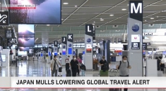 Japan mulls lowering global travel alert